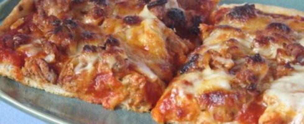Sausage pizza on Pfaltzgraff